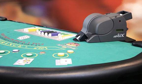 Card shuffling machine casino odds percentage sign outside casino